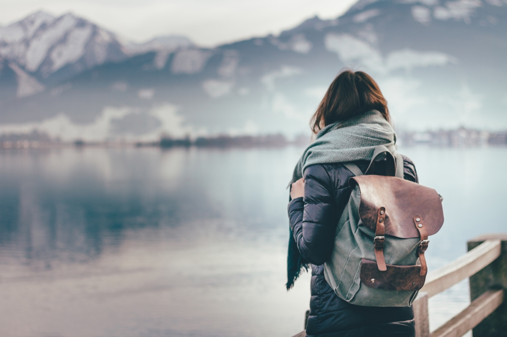 Traveler looks at landscape